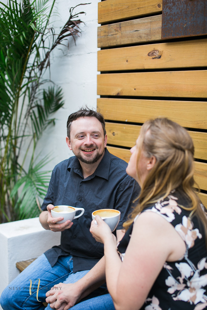 couple laughing at Foundation coffee co engagement photoshoot- Tampa Florida  wedding photographer