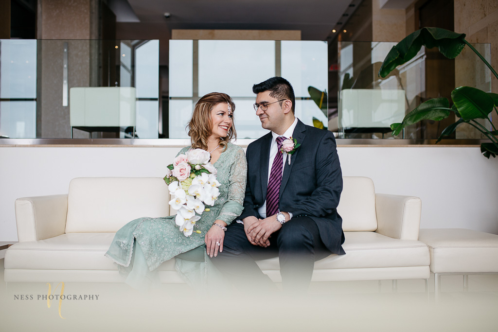 Bridal photos for pakistani wedding in Montreal old port-- bride and groom on couch