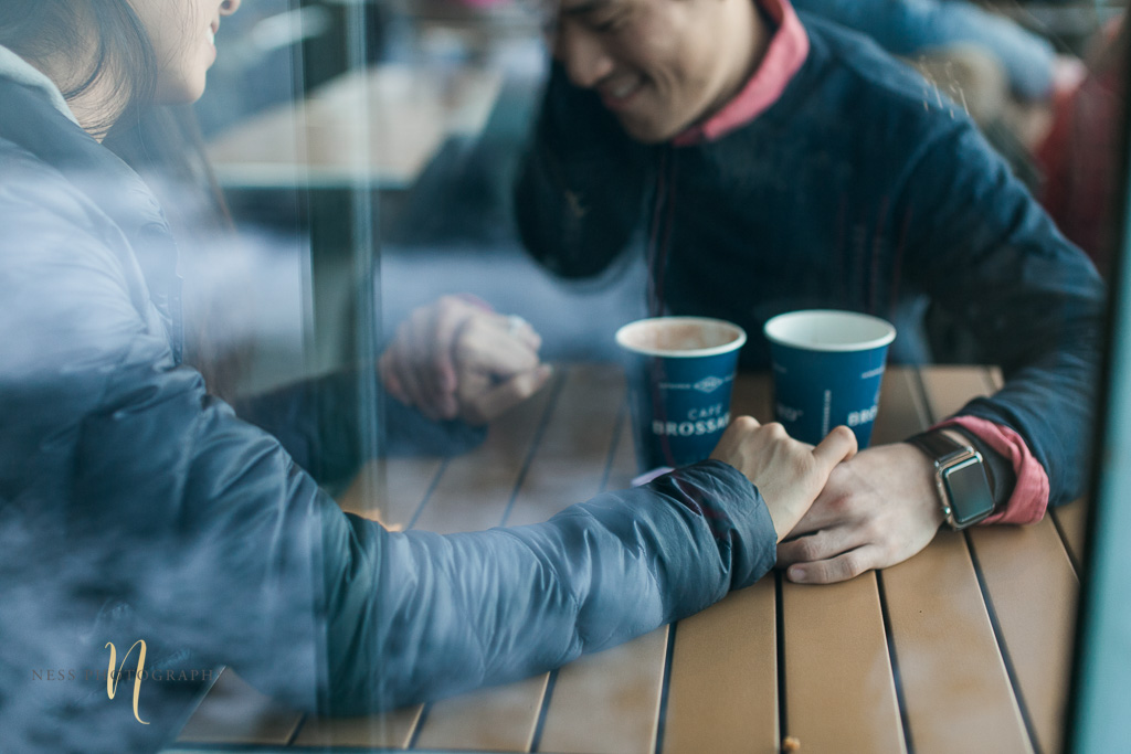 coffee shop engagement photoshoot in montreal old port - couple holding hands