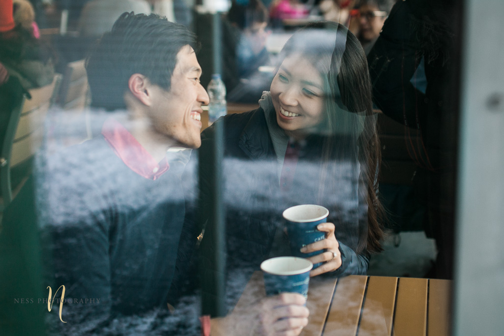 coffee shop engagement photoshoot in montreal old port - couple having coffee