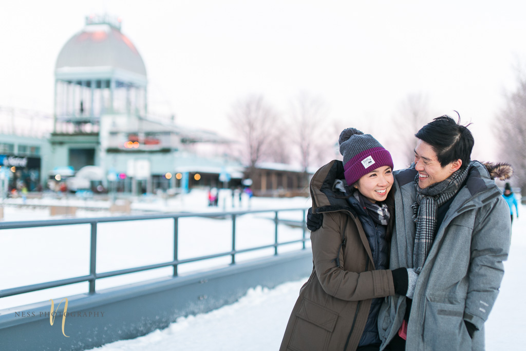 couple in front of bonsecours at winter sunset engagement photoshoot in montreal old port