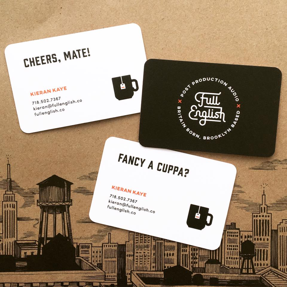 The business card designs in context.