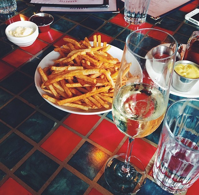 Sometimes a broad needs a bowl of fries and a flute of bubbly.