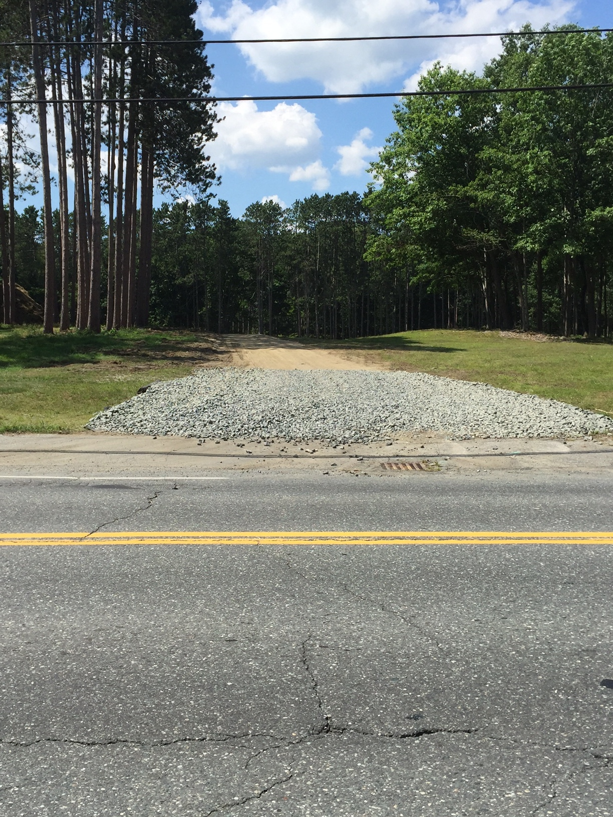 Note that the photo shows large rock on the haul road at the entrance.  This is good practice to reduce mud and dirt from truck tires as they enter public streets.