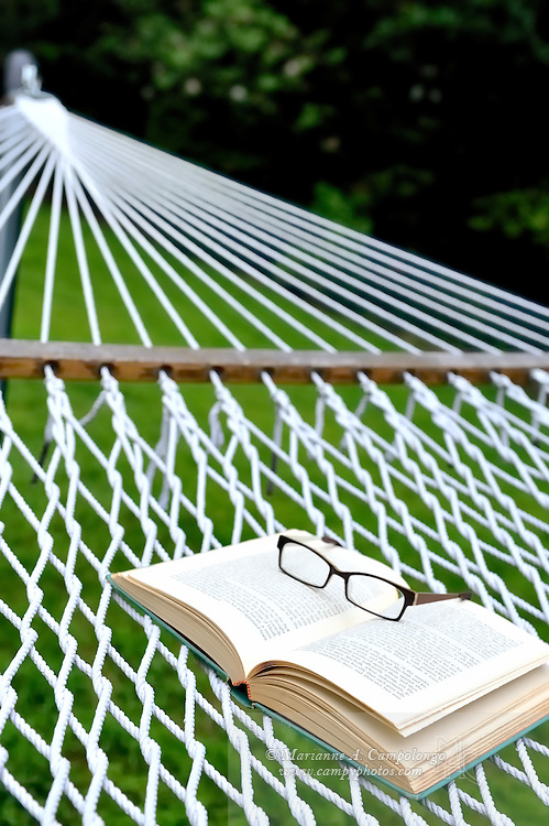 Summer reading: glasses and book on hammock