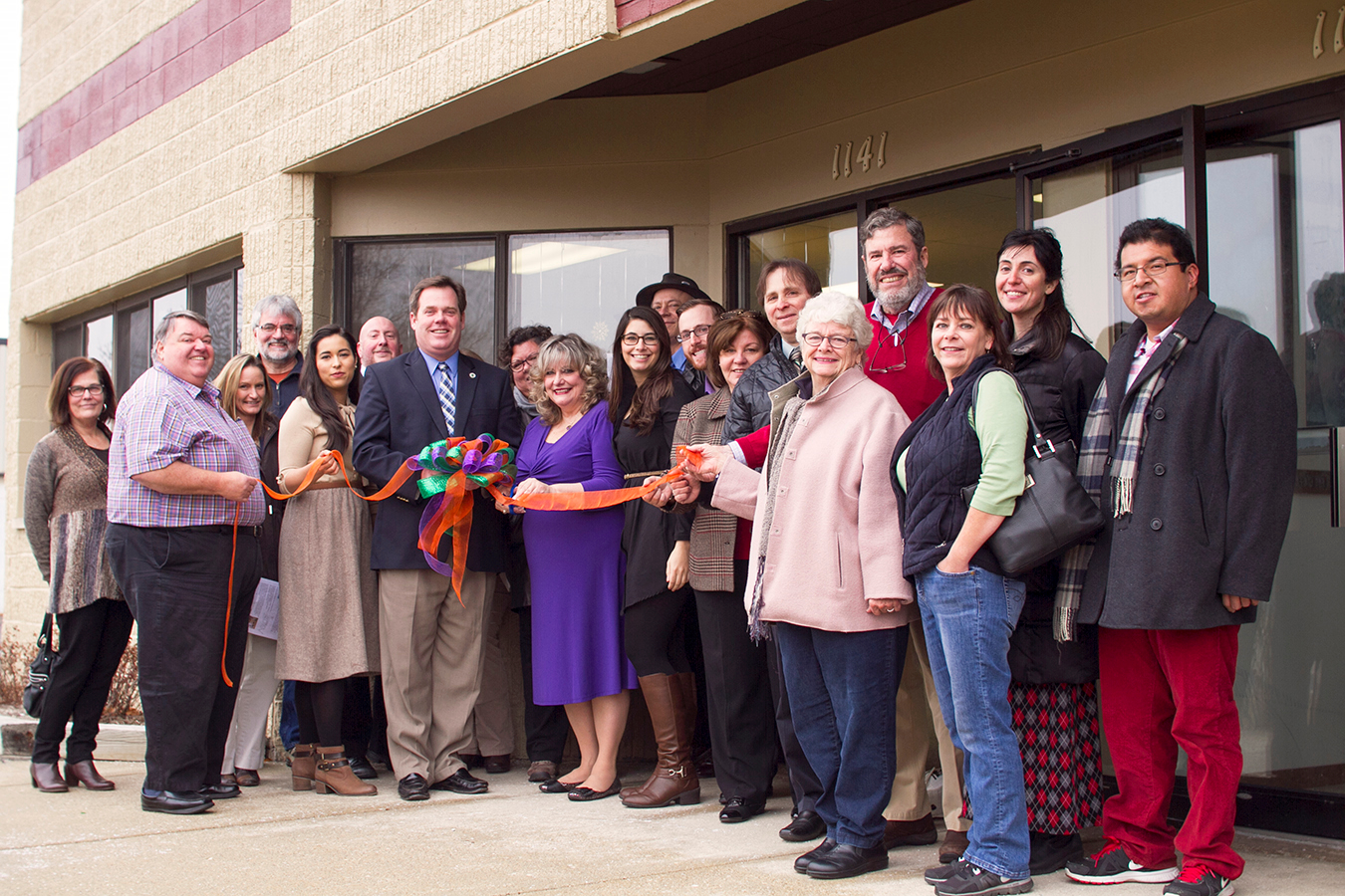 Ribbon cutting with Geneva Mayor Kevin Burns and so many do-over,me friends. December 1, 2014.