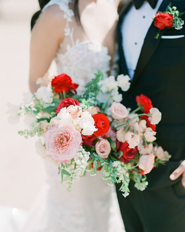 When we were working on this wedding we were planning on keeping the bridal and ceremony flowers a very soft palette. However, our bride loved color, especially red and really wanted to incorporate it throughout the entire wedding. And I am so glad she did, the saturated color made the wedding so magical! . Red isn't always easy to work with so we added some muted, muddy colors to bridge the lighter colors with the more saturated ones. And now you have a peek into how we work out our designs. #color, #shape, #composition #collaboration #dontbeafraidofcolor . @outstandingoccasions @racheltroyan @charitymaurerphoto @elchorroweddings