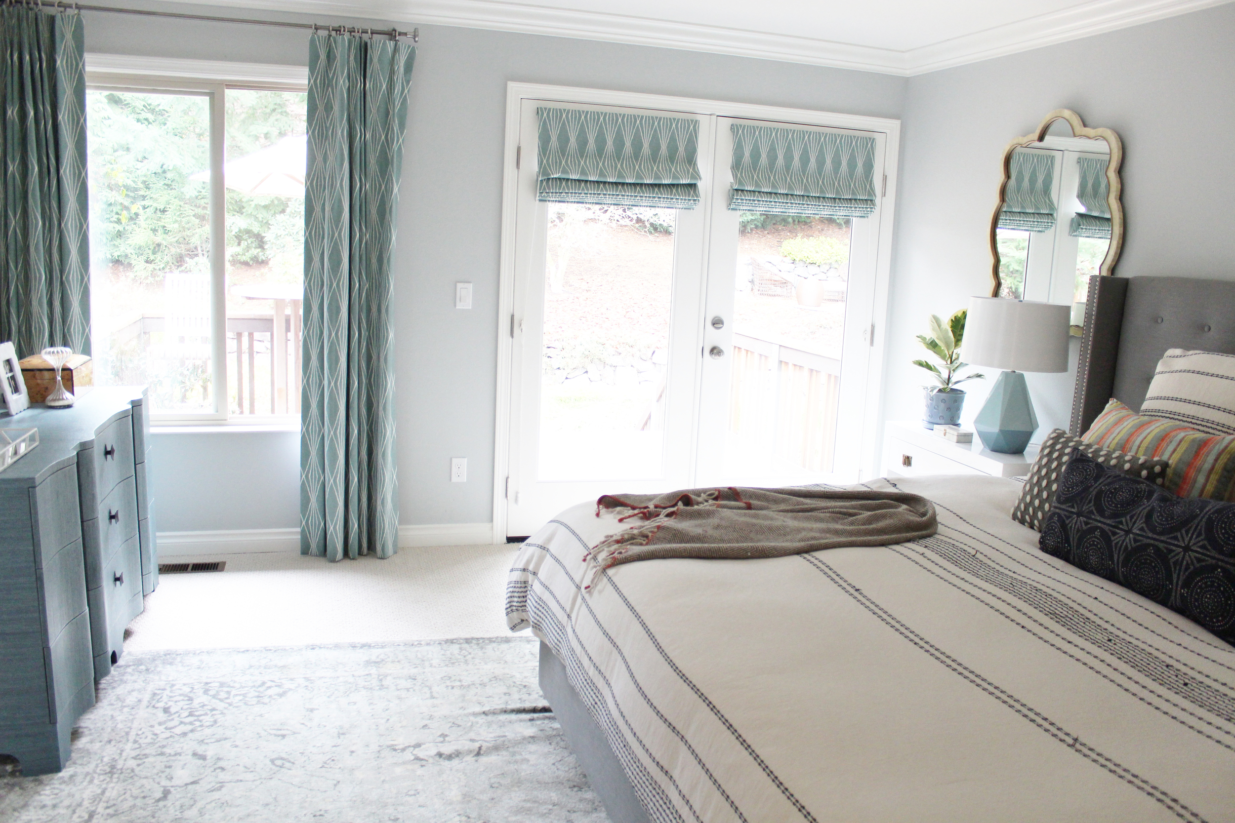 Tranquil master bedroom designed by Manderley Design Co.