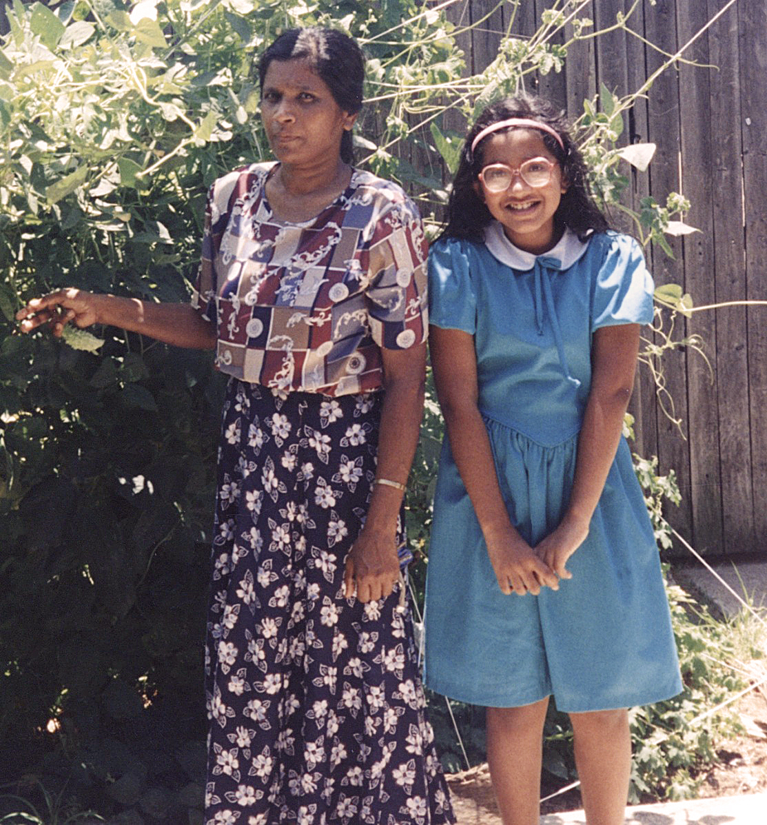 Young Marily with serious but beautiful mum.