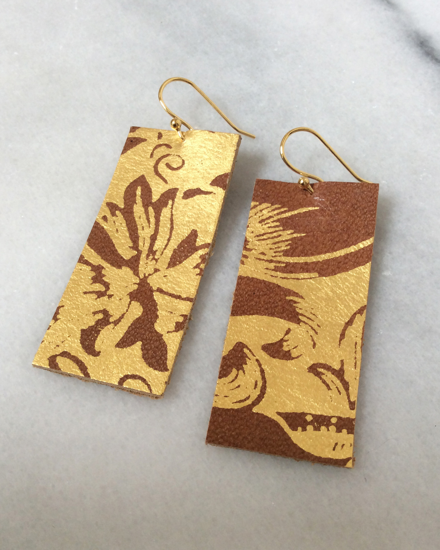 Leather earrings with gold leaf.