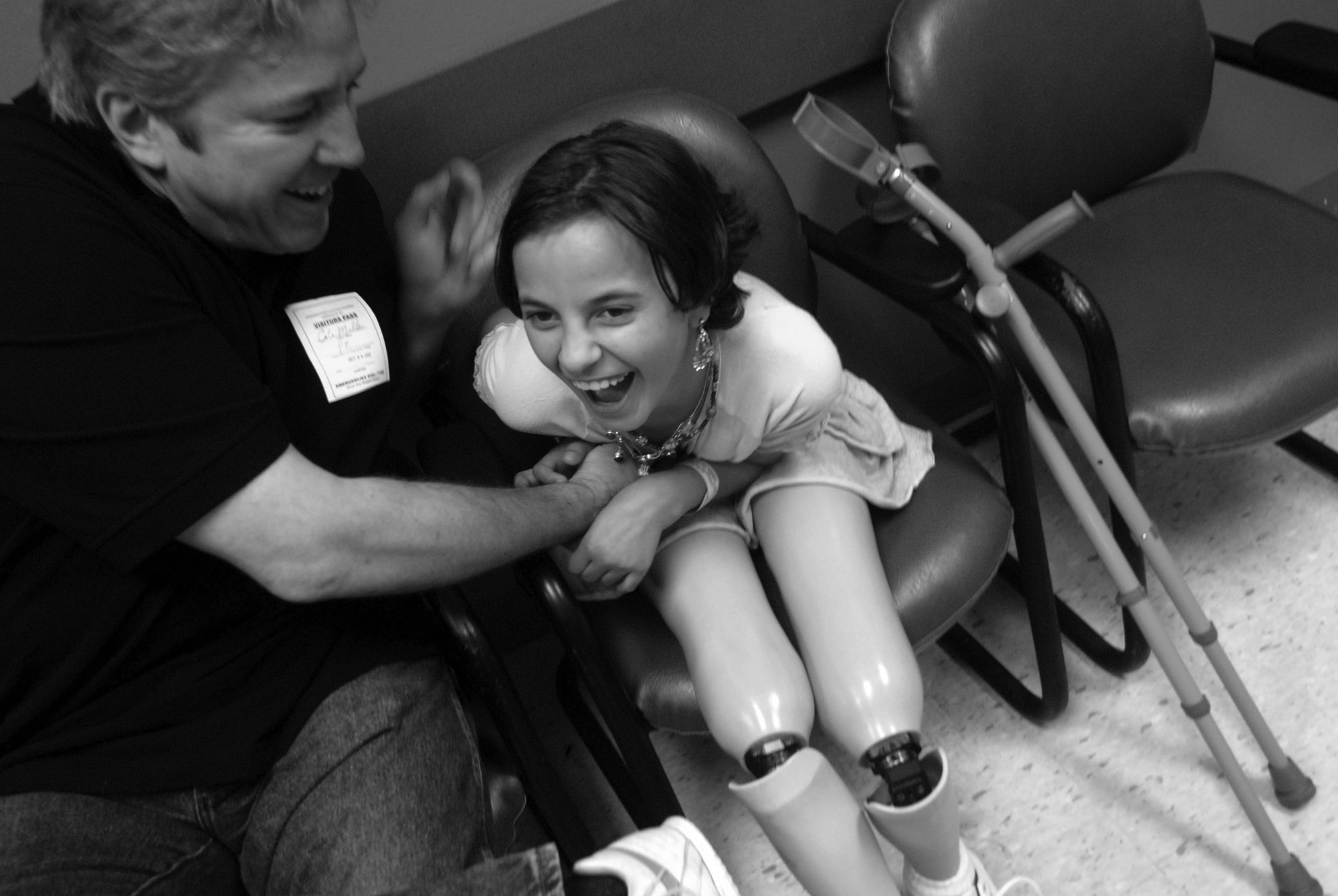 Cole Miller, left, tickles Salee Allawe as they attend her last doctor's visit at Shriners Hospital before she travels home to Iraq.  (October 8, 2007)