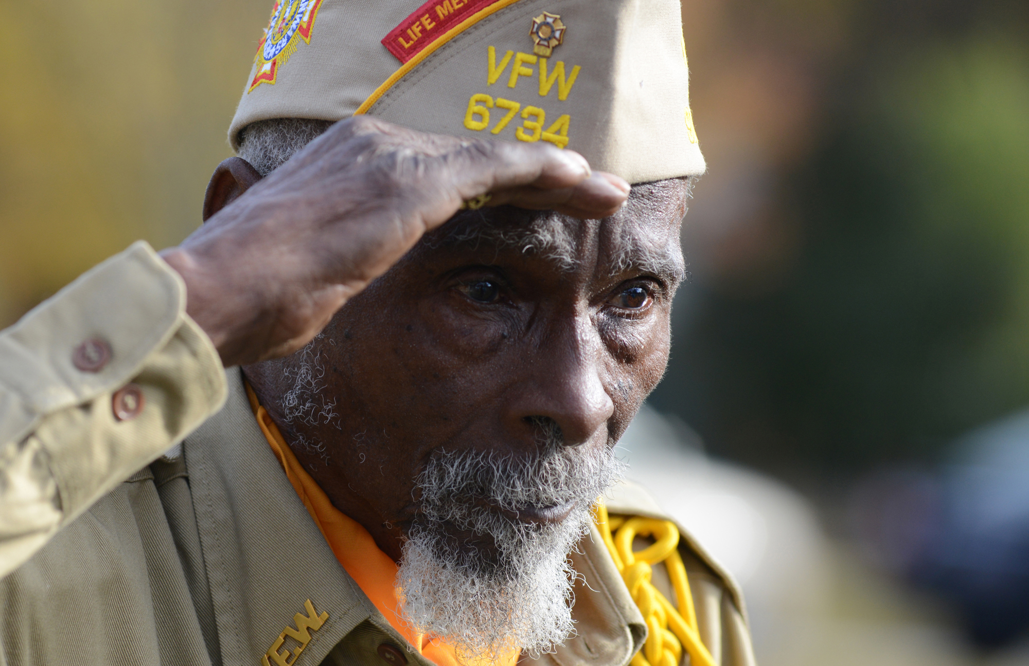 Tomie Gaines, a Buffalo Soldier, salutes during a Veterans Day Ceremony at the Historic Richland Cemetery.