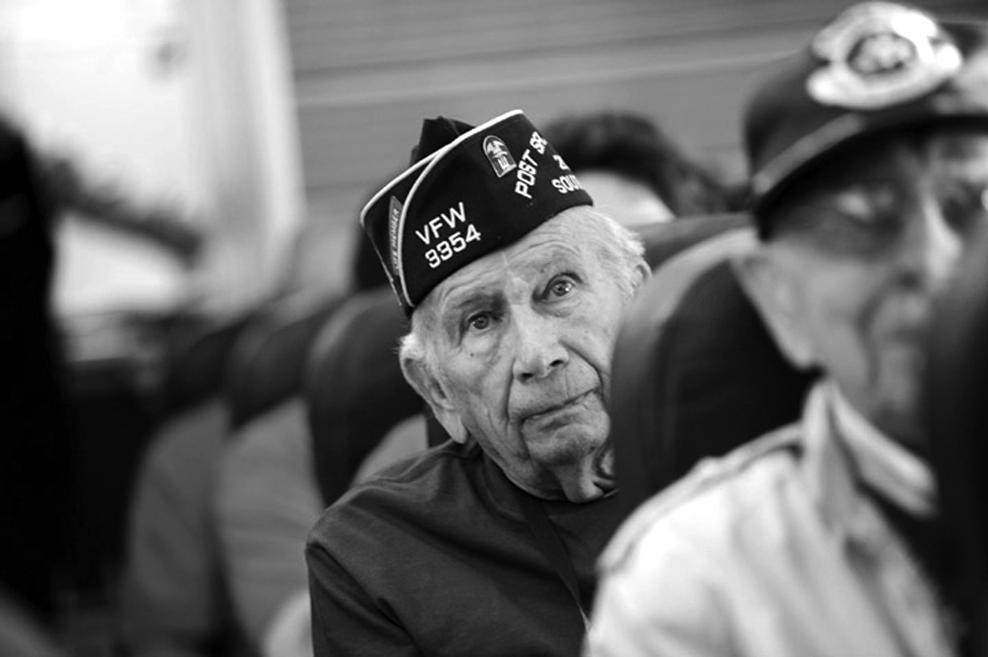 World War II veterans traveling from South Carolina to Washington, D.C., sit on a charter plane.