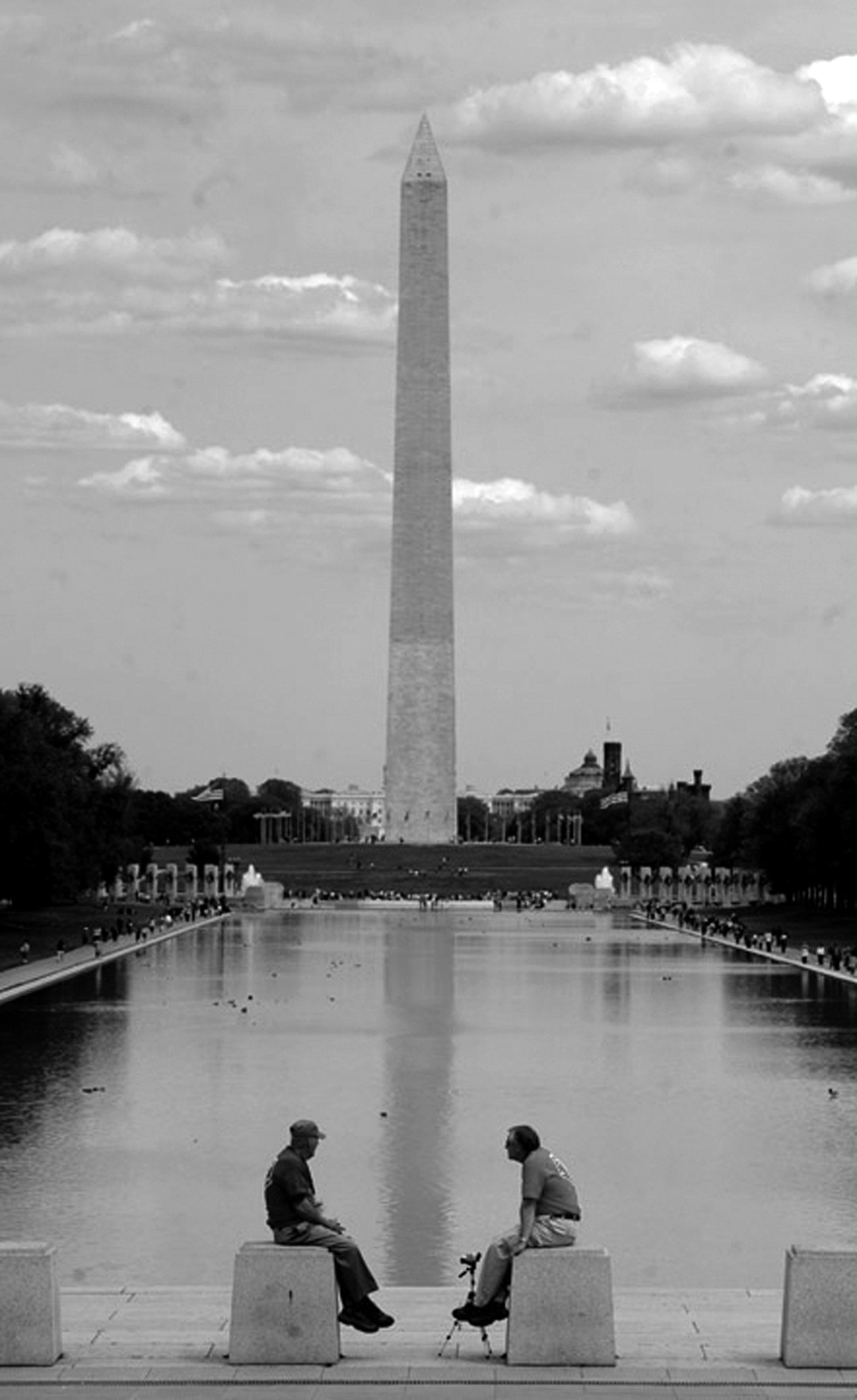 A veteran and his volunteer take a short break near the Washington Monument.