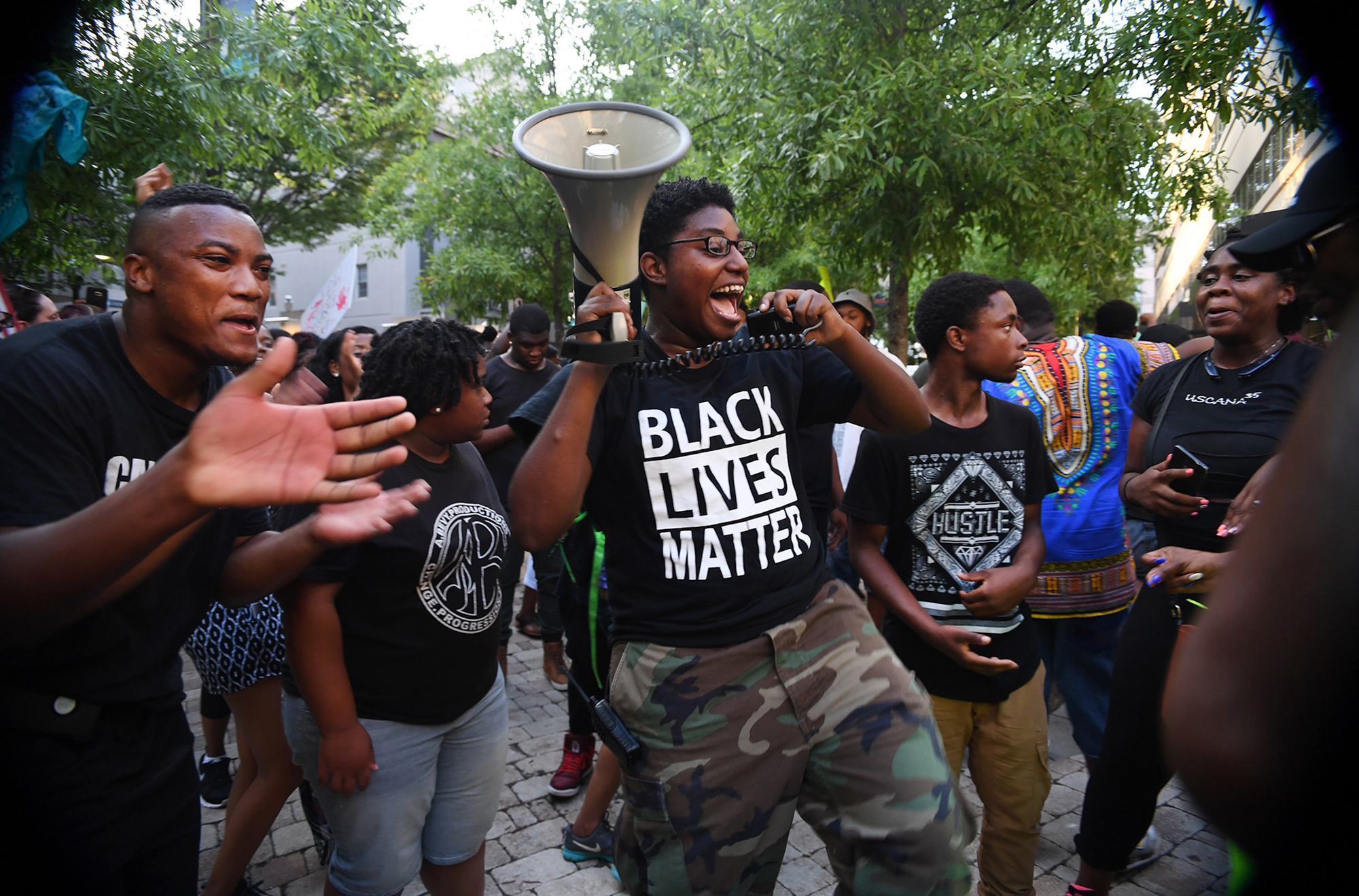 During the second night of a Black Lives Matter peace rally, a group of protestors cheer in NOMA Square in downtown Greenville before being asked to leave.