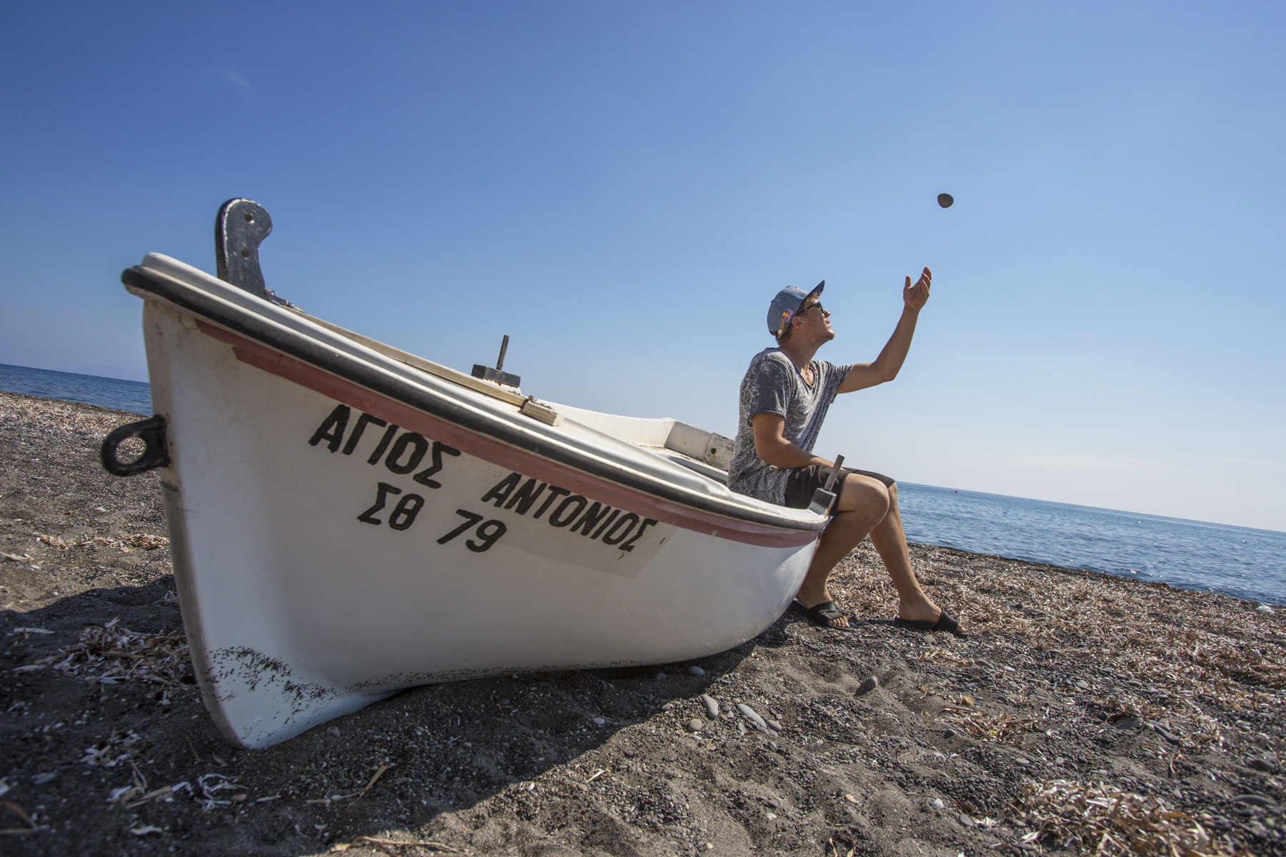 Jason Paul, playing on the black beach in Perissa Beach.