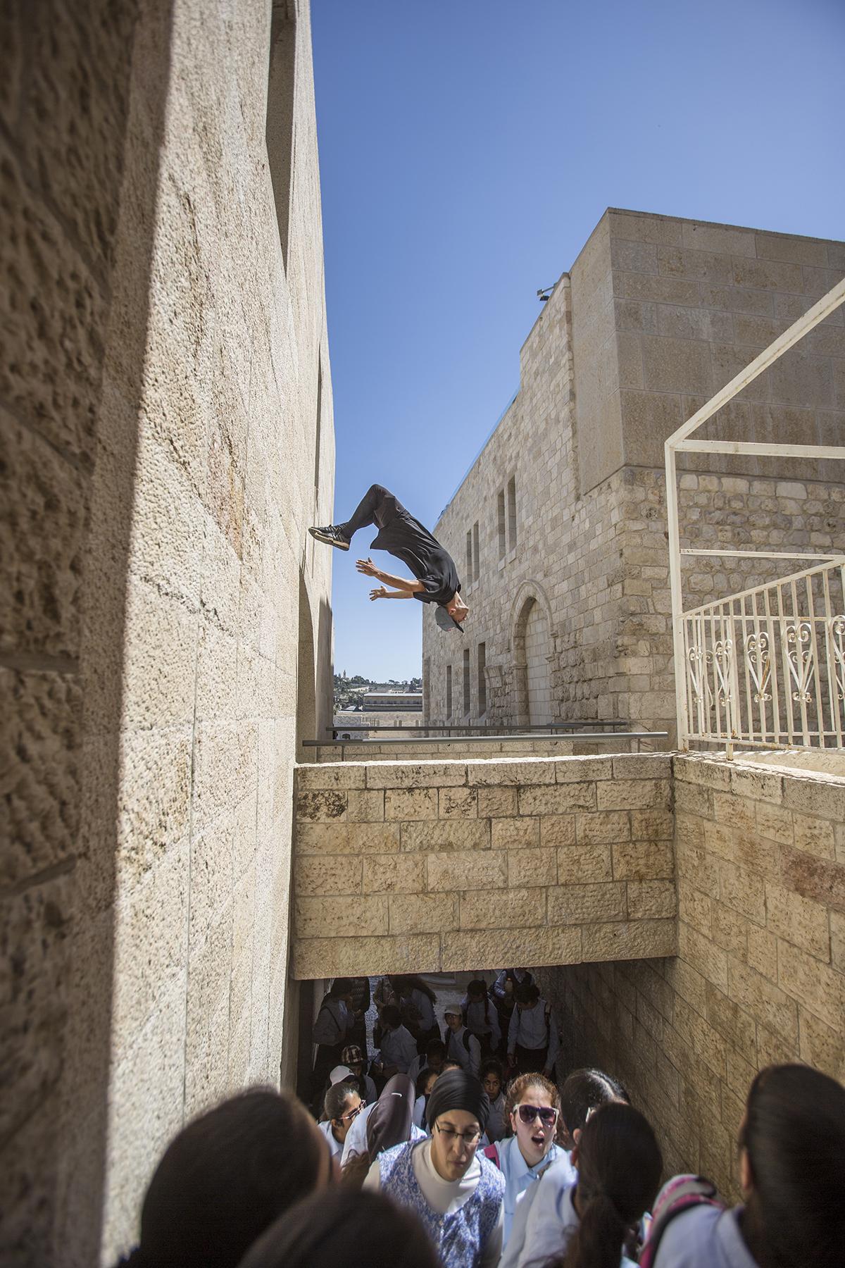 Jason Paul wall flipping in Jerusalem.