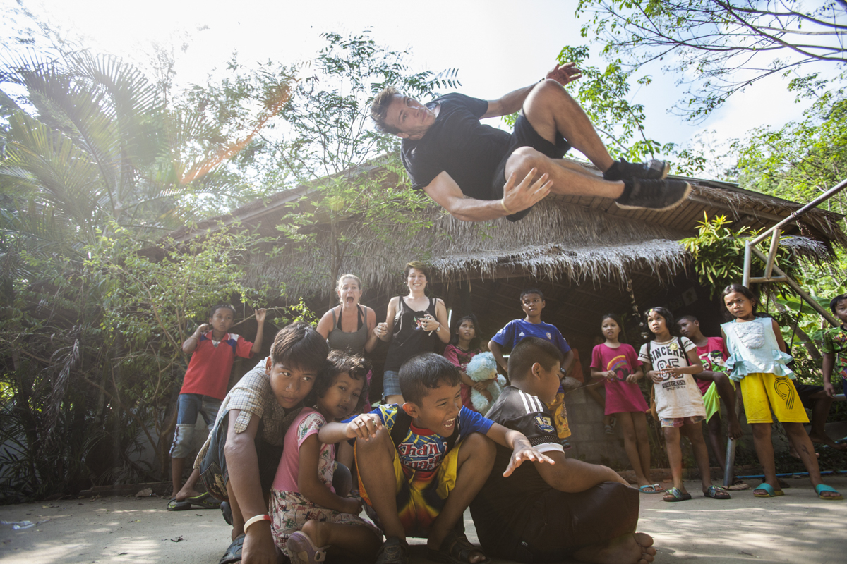 You can see the volunteers freaking out in the back. Lol. No children where hurt during the making of this photo. In fact Jason's side flip had to be repeated about five times so all brave children had a turn.