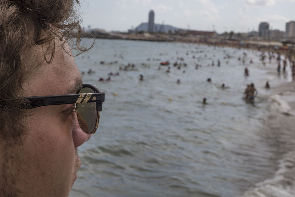 Josh Dohy looking out on the beach in lovely Barcelona.
