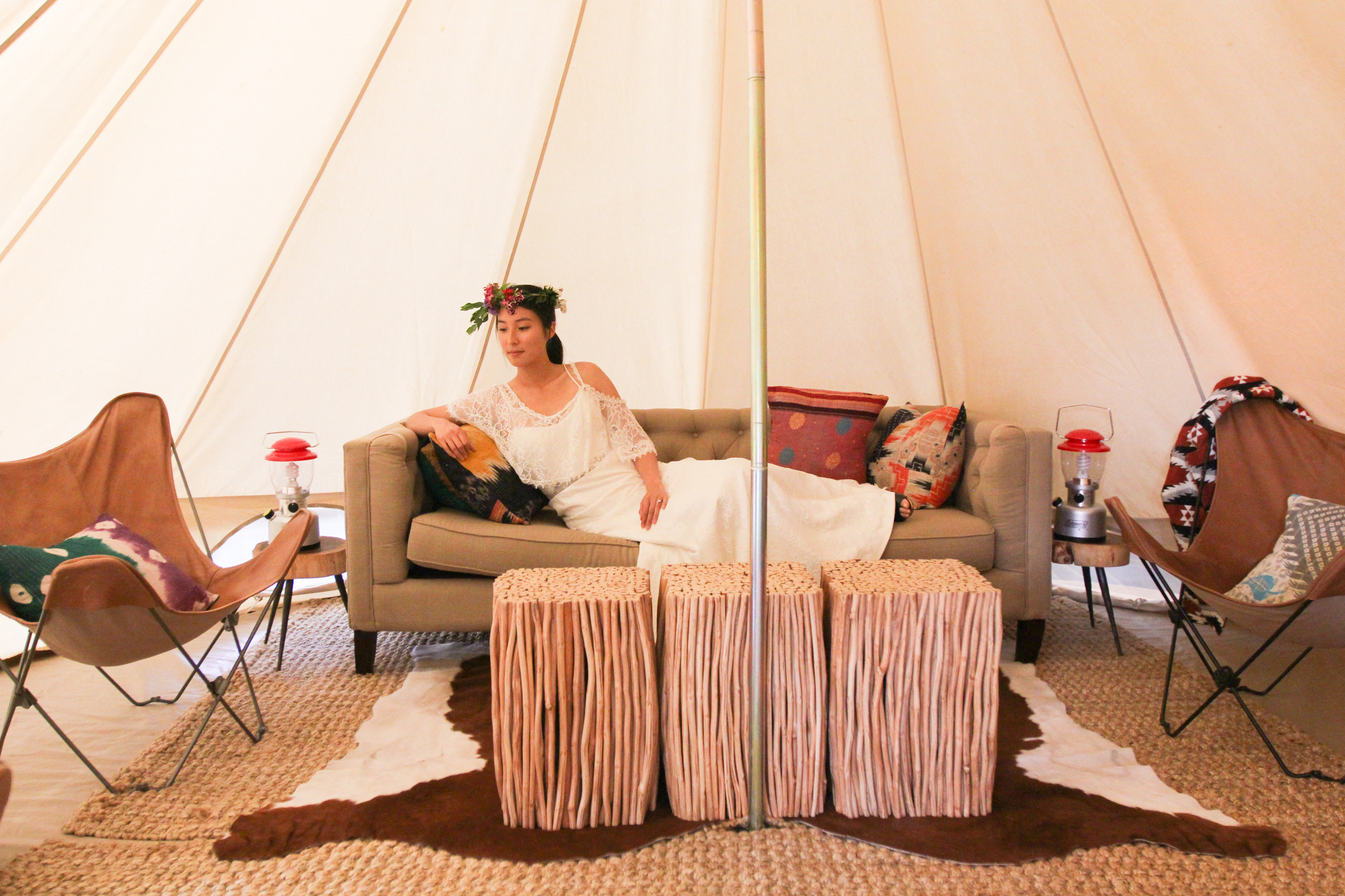 Lounge in the  Joni wedding dress  in a luxury tent by  Shelter Co .