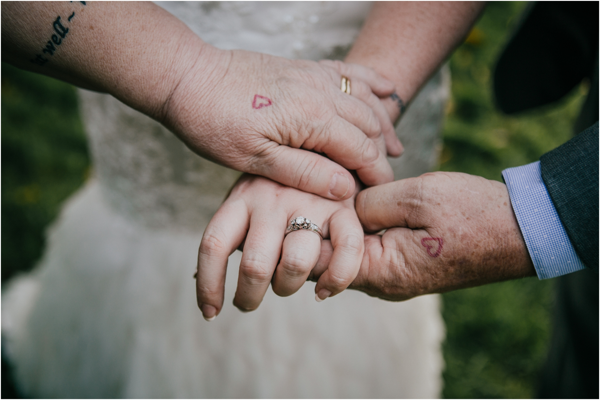 One of my favorite photos from the day! Bethany had drawn a little heart on her parent's hands one day, and they ended up getting it tattooed on!