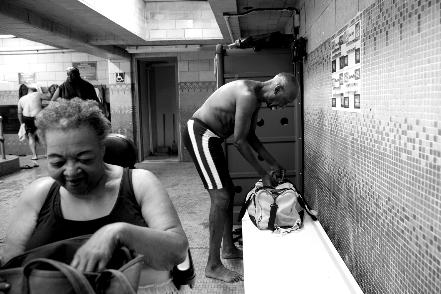 Rasheedah Ali (left) and Luther Gales prepare for the Harlem Honeys and Bears practice on June 26, 2017, in the Hansborough Recreation Center. Both Ali and Gales are longtime members of the all-black synchronized swim team that practices in Harlem, New York.