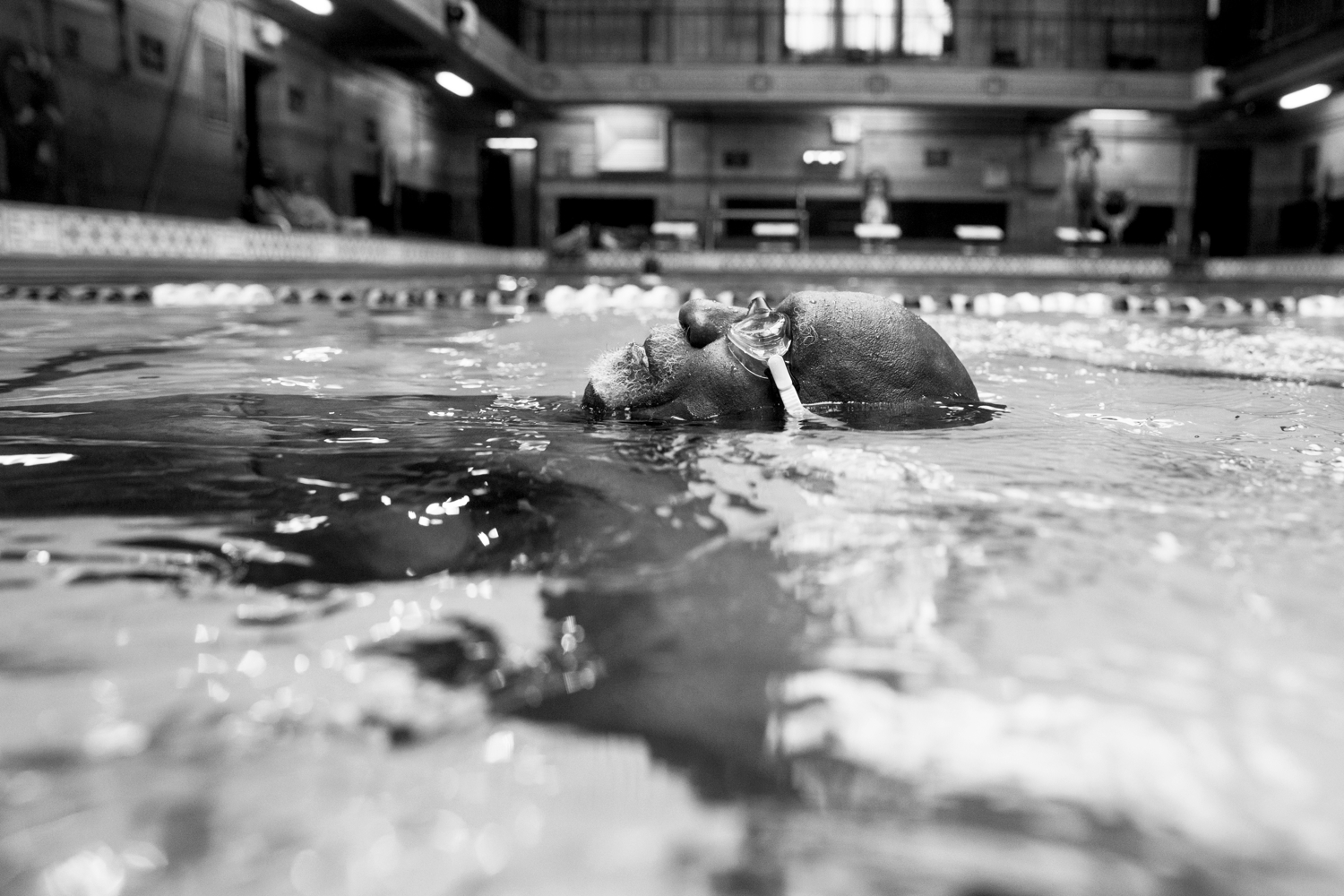 Luther Gales practices the backstroke during practice on July 14, 2017, at the Hansborough Recreation Center. The team practices three times a week for one hour.