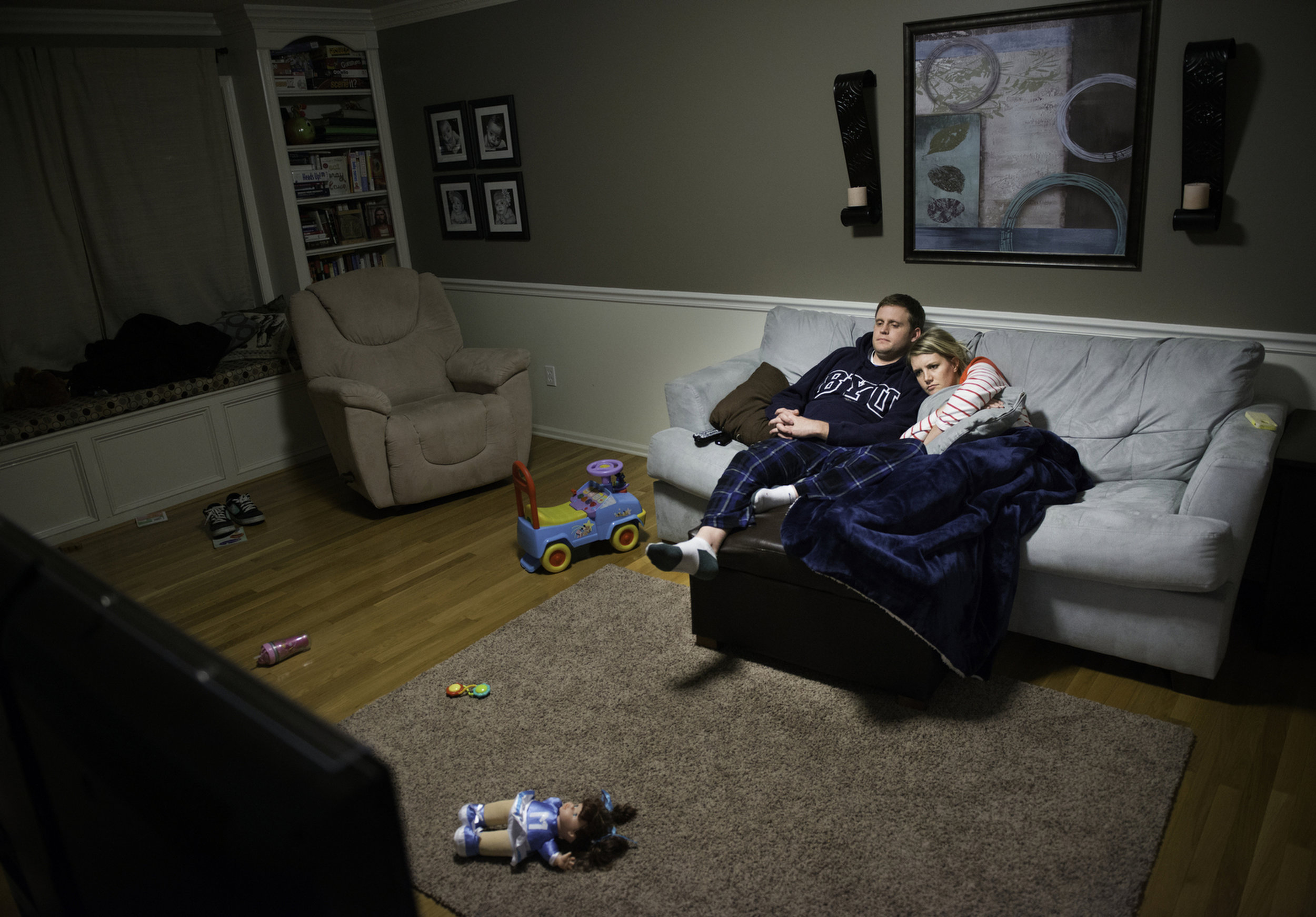 Cameron and Courtney watch a movie to unwind after a long day on Nov. 21, 2014. Most nights they fall asleep on the couch or go to bed early because they are so exhausted and drained.