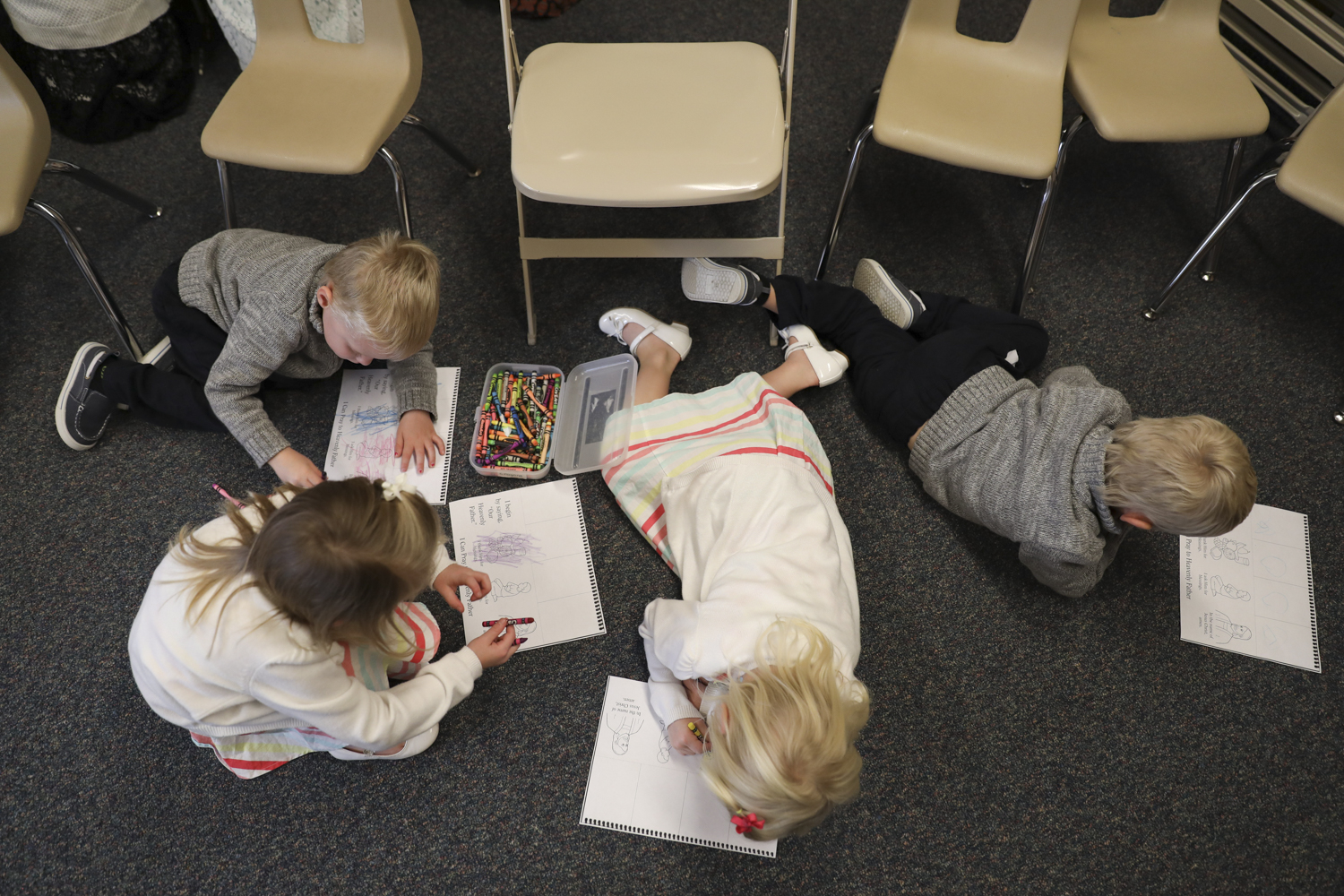 The quadruplets color during religion class on Oct. 23, 2016 at The church of Jesus Christ of Latter-day Saints Geneseo ward, Rochester Stake.