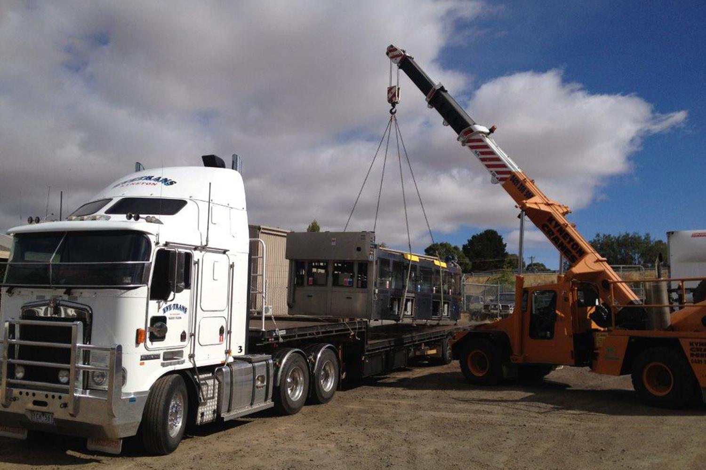 machine being crane loaded.jpg