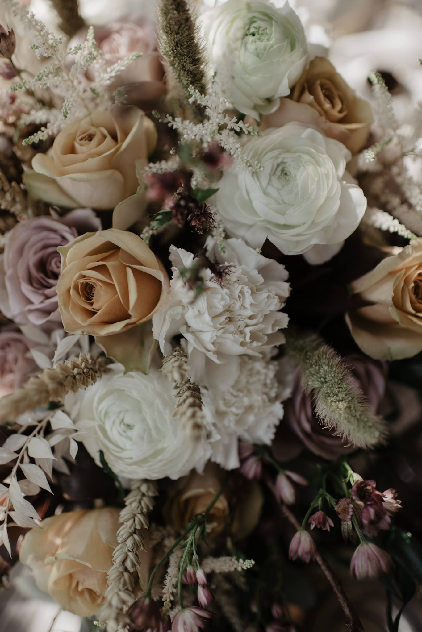 Bridal bouquet with soft muted tones of lilac and orange