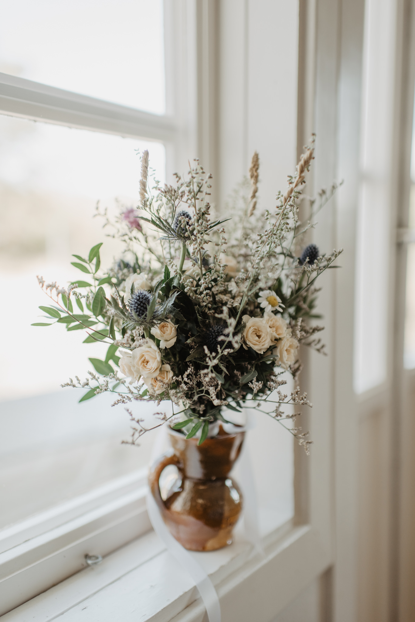 Chic small wedding bouquet with dried flowers