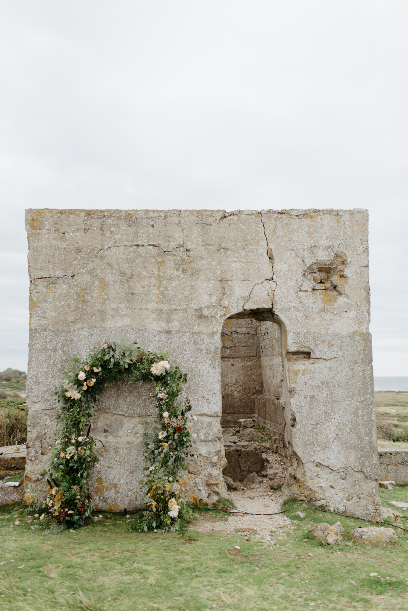 Beautiful floral wedding arch at a Swedish ruin