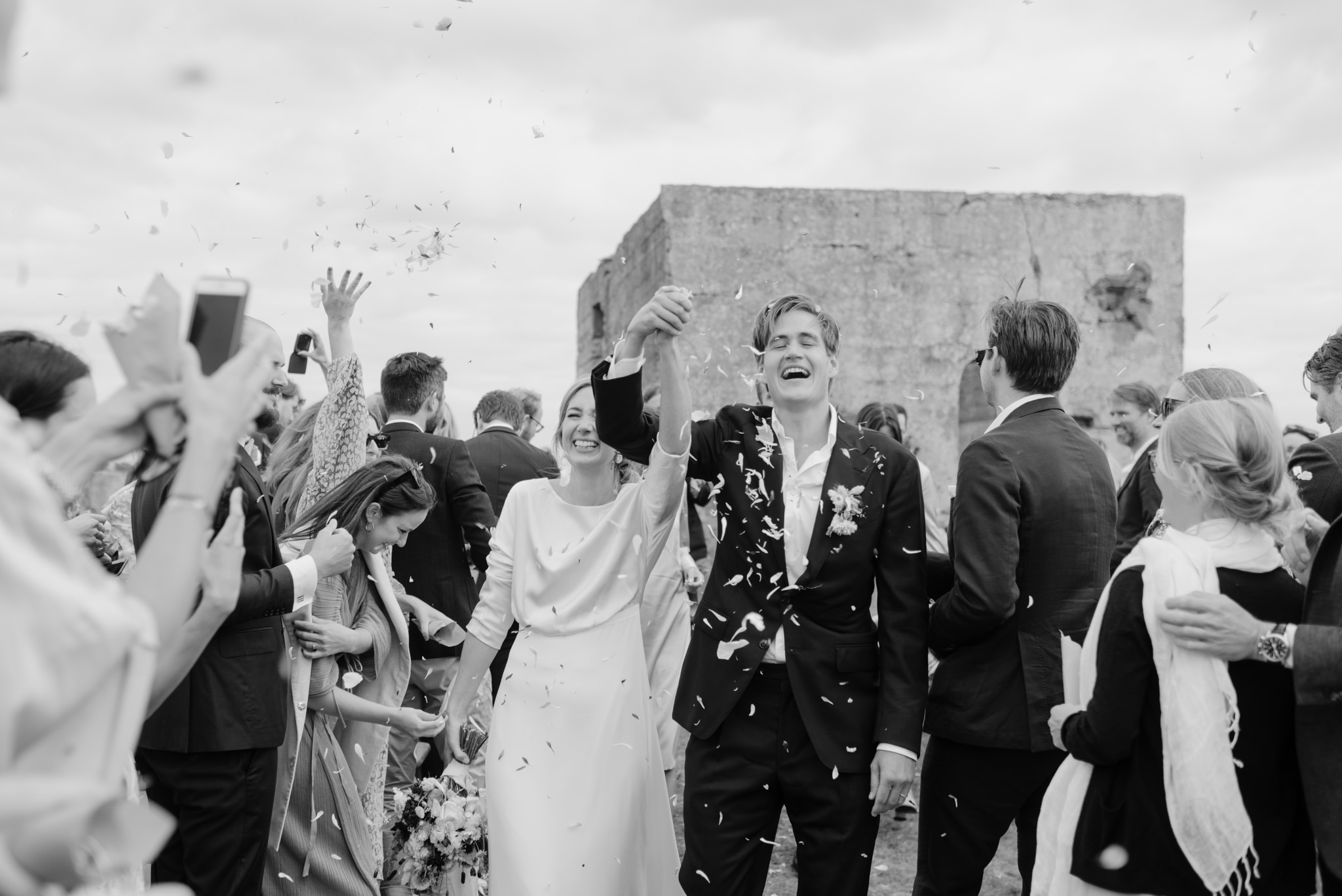 Newlyweds being showered with confetti