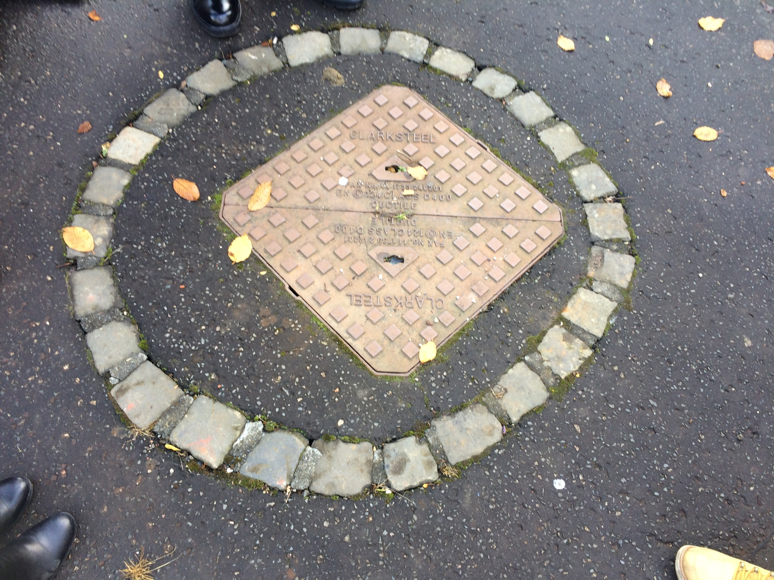A manhole cover is the only marker for the location of the production well