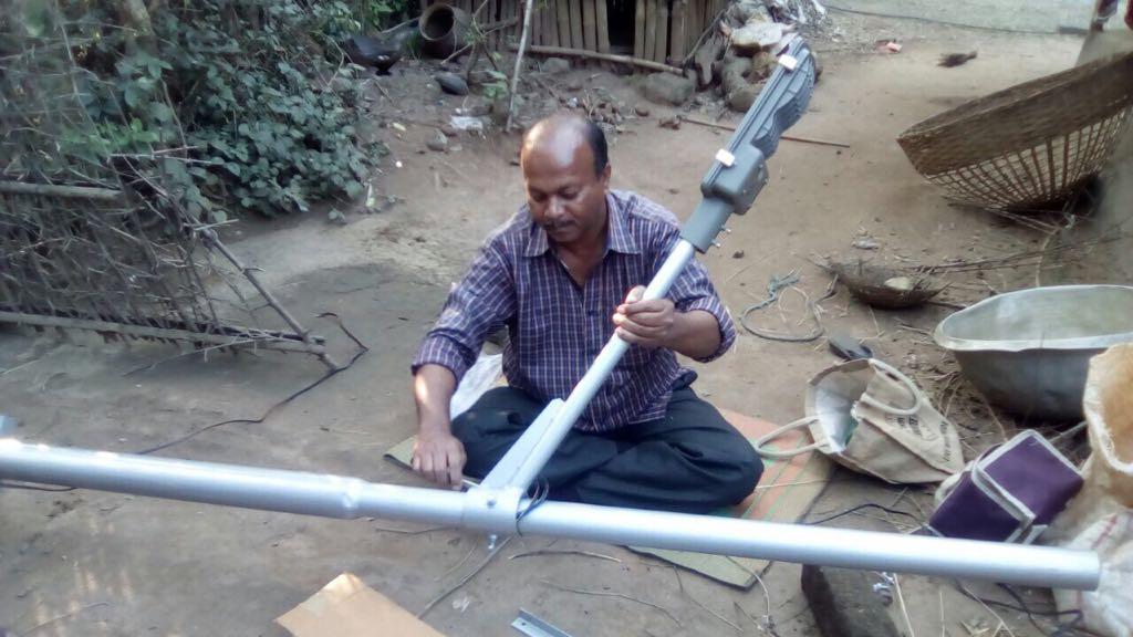 Bindu putting together a streetlight in Mayurbhanj.