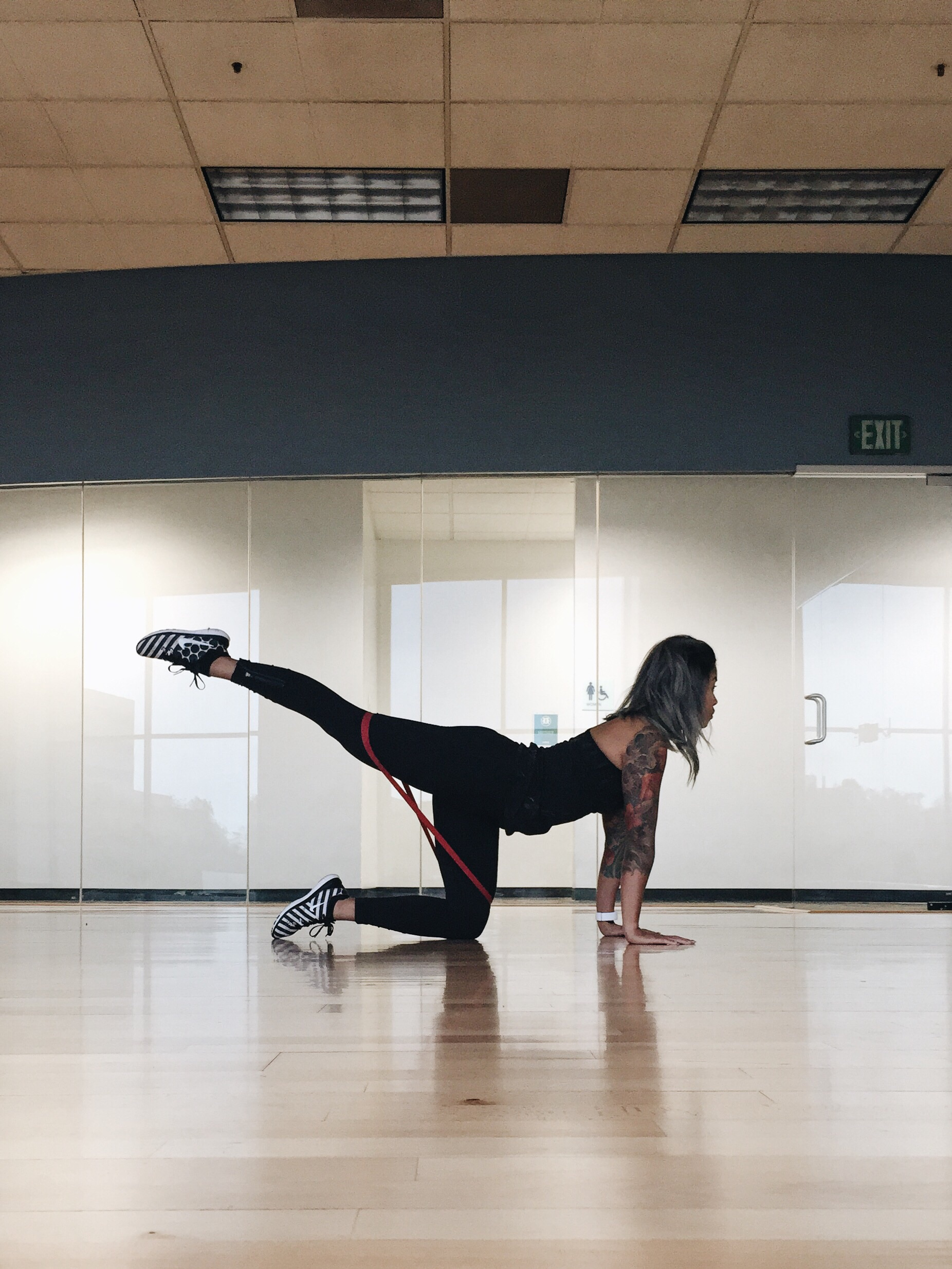 Straight leg donkey kicks -For the donkey kicks place the band above your knees, straighten one leg and lift up squeezing your glute, lower down with control.