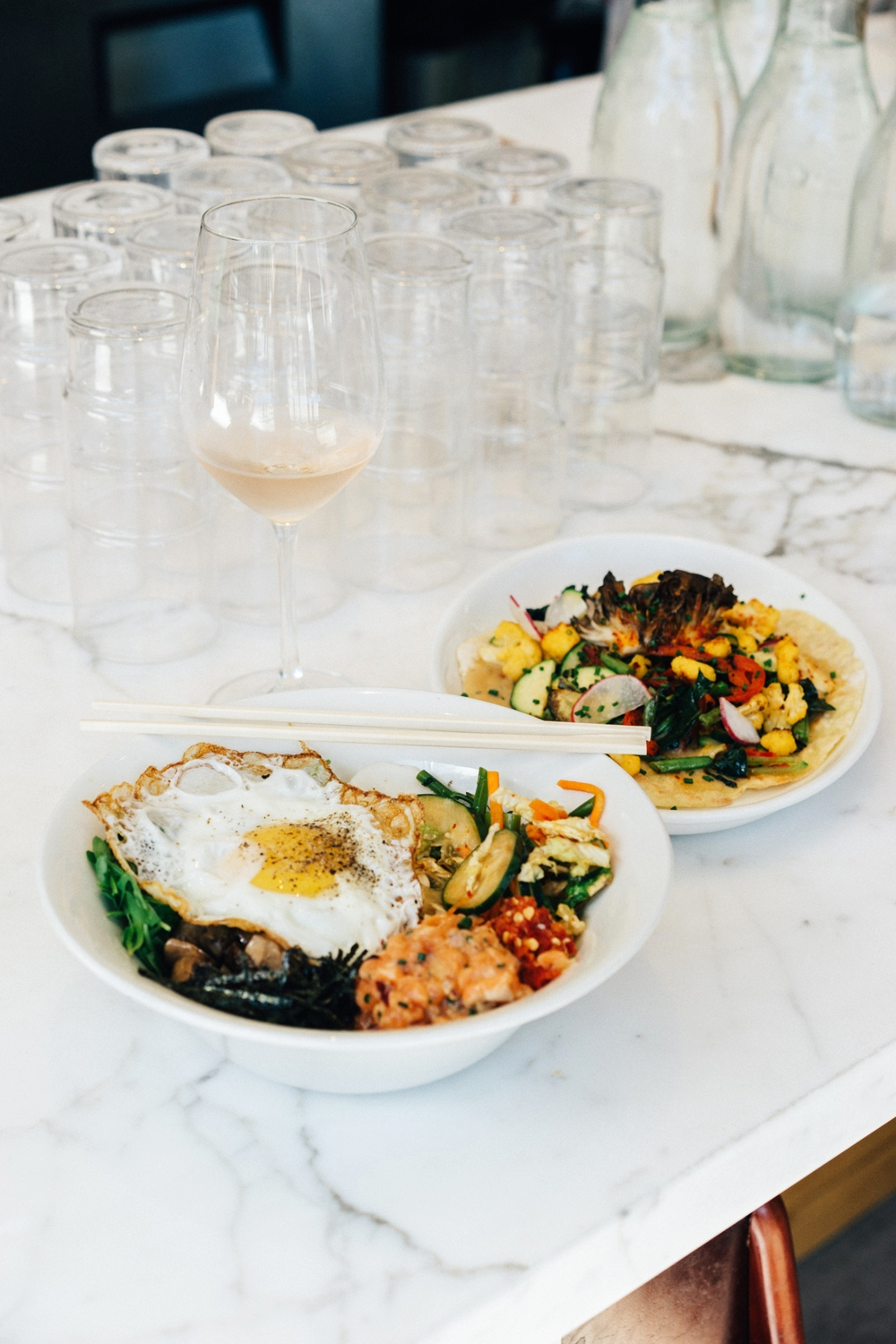 Bibimbap - Spring vegetables, brown rice, chili garlic sauce, fried egg   Field Greens Flatbread  - seasonal harvest, almond-onion puree