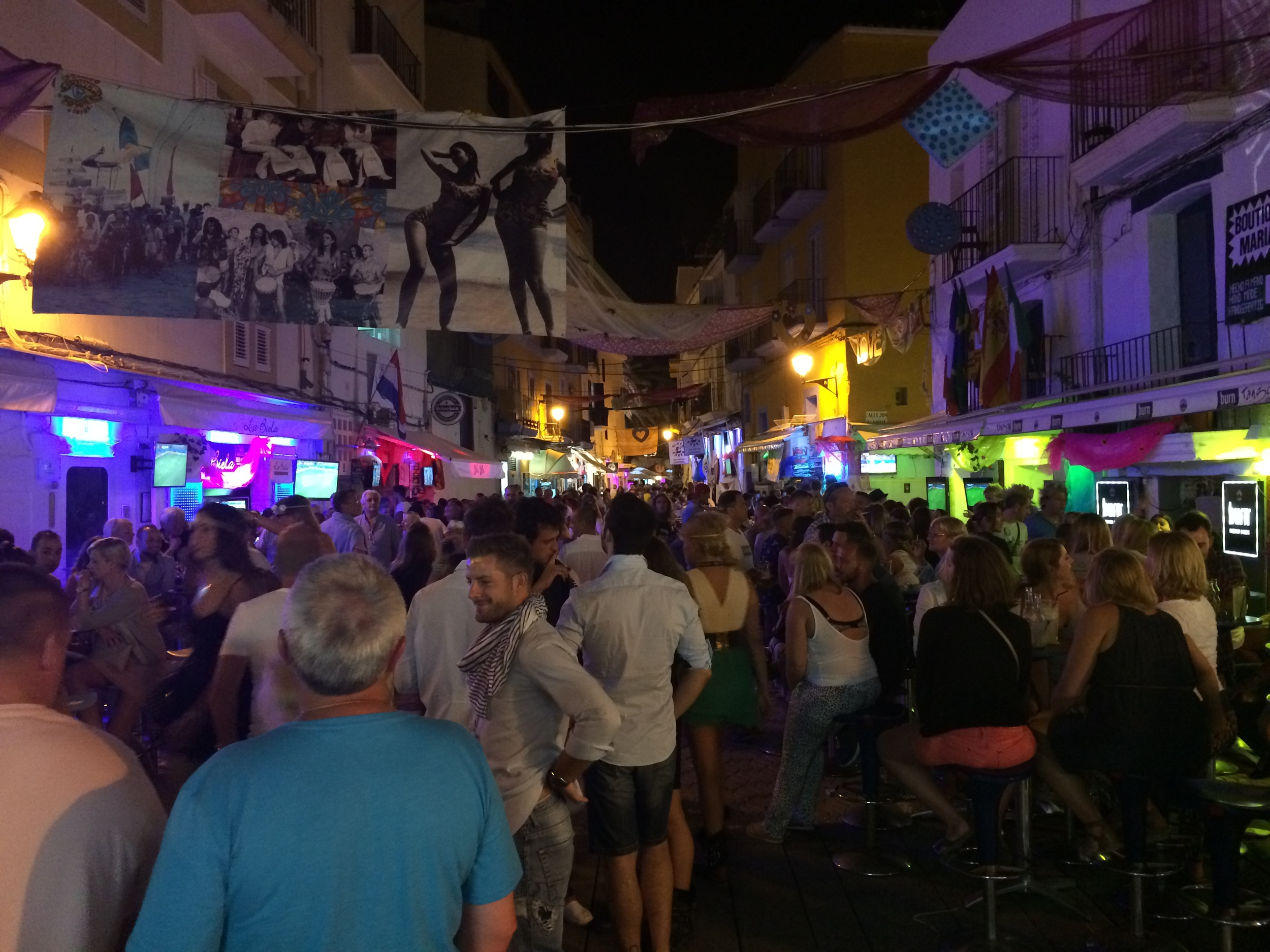 The streets of Ibiza Town at night. The congestionreminds me of New York.