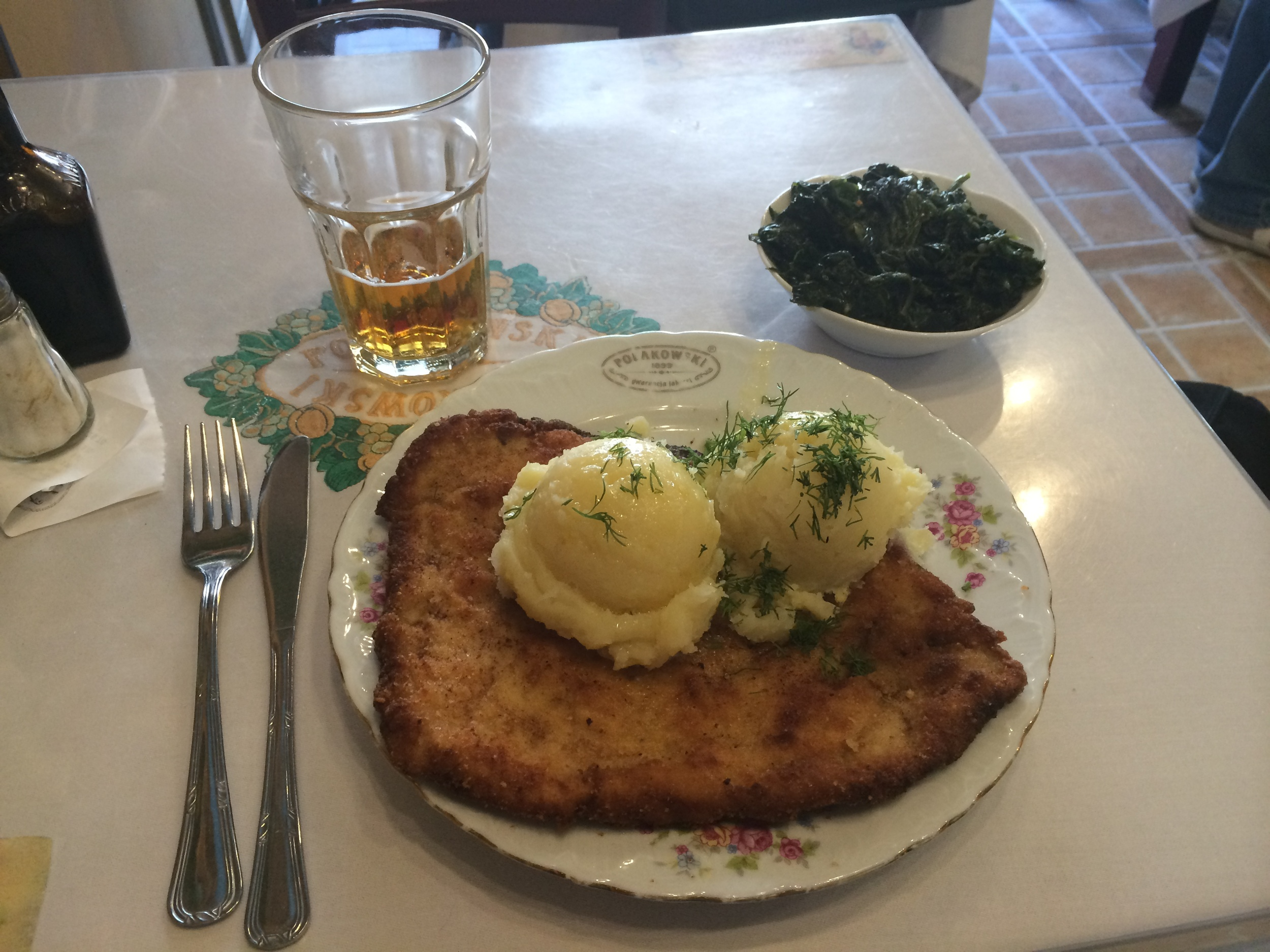 Time for some food! Can you believe this plate of happiness (called Kotlet Schabowy), vegetables, beer, and Zurek (not pictured) cost less than $6!