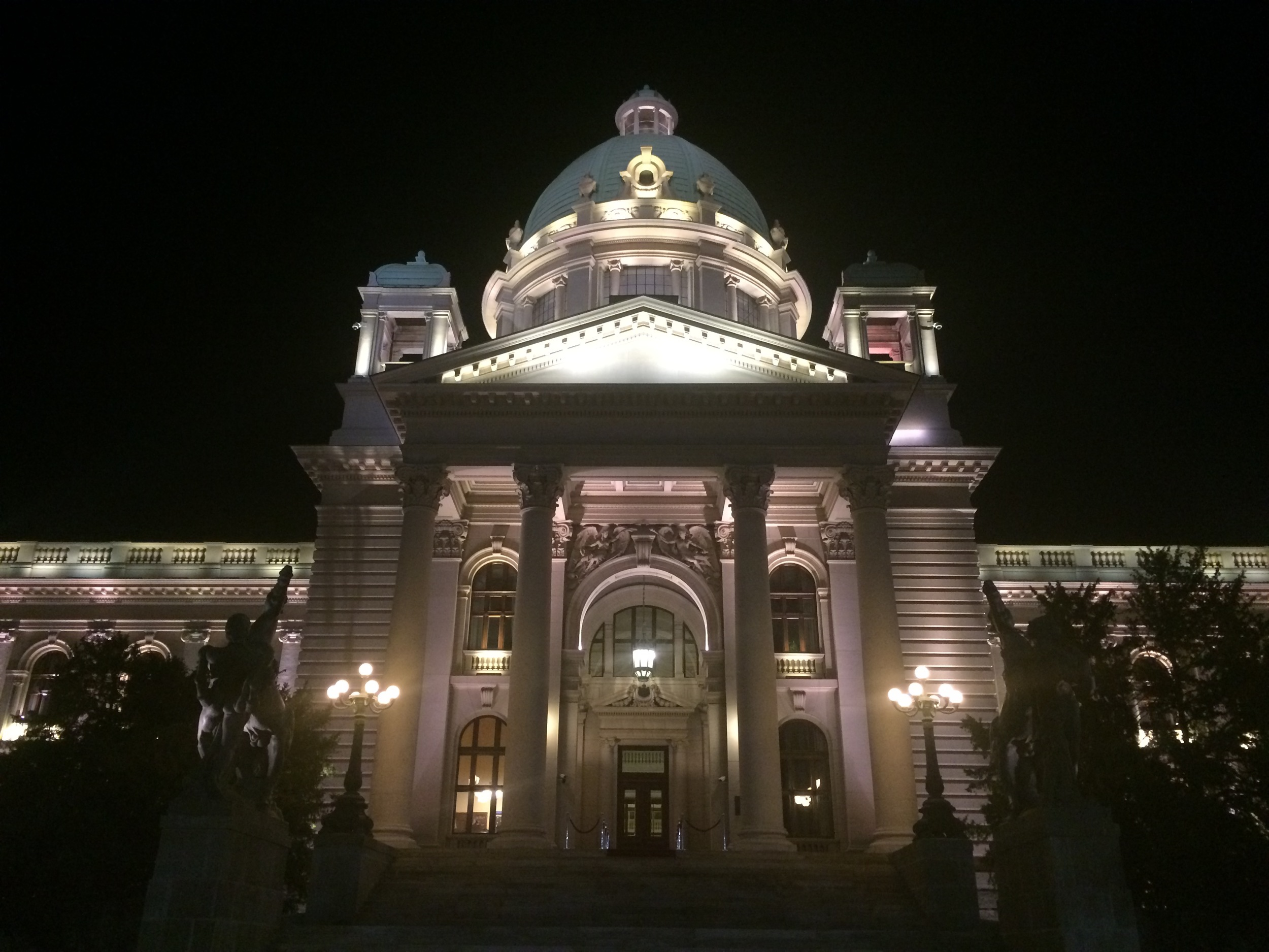 View of Belgrade's National Assembly building at night.