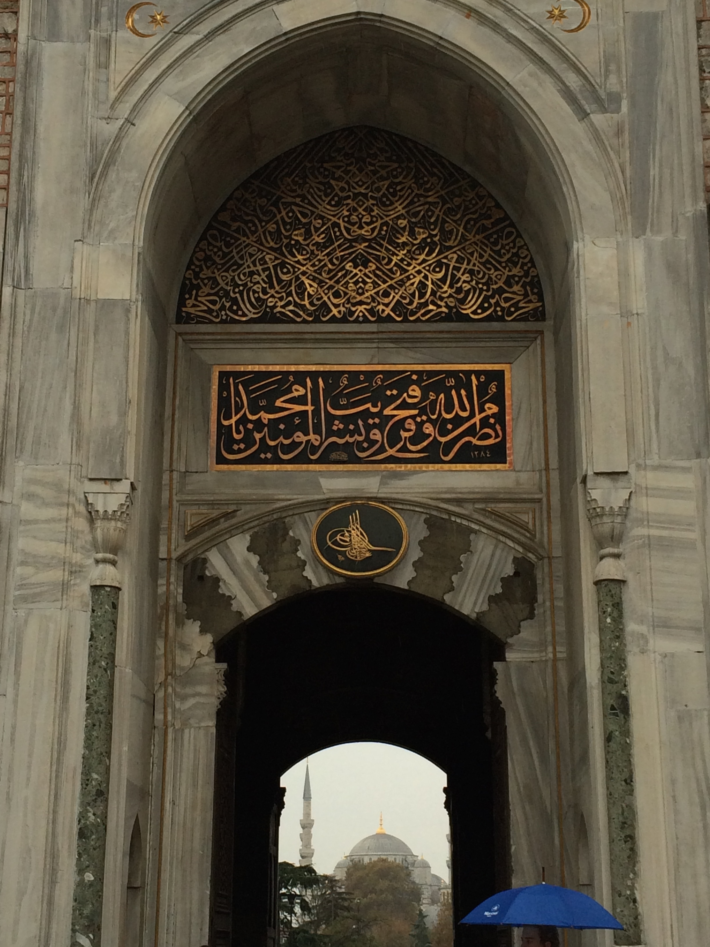 The entrance to the Topkapi Palace with the Blue Mosque in the background.