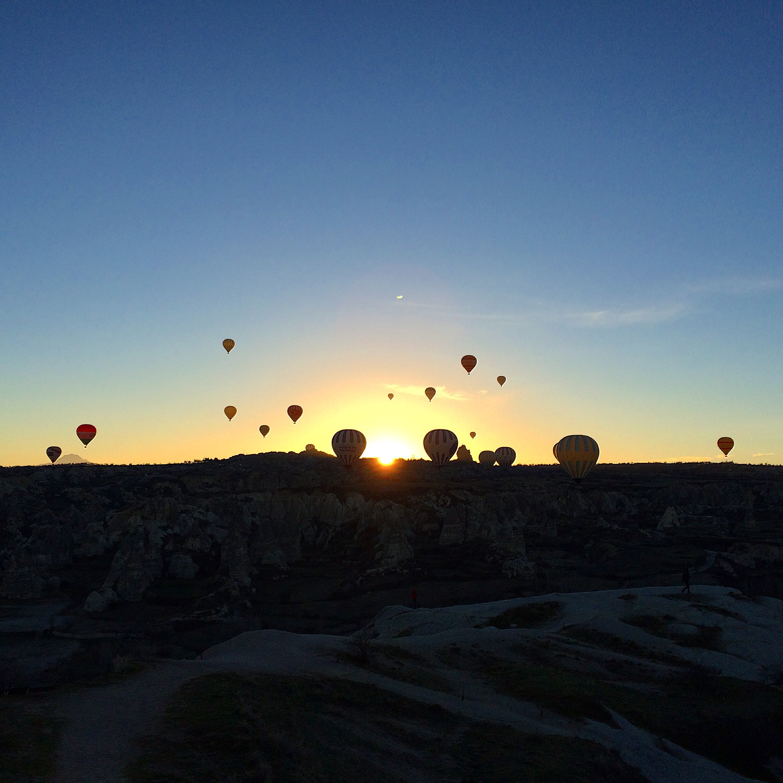 Hot air balloons at sunrise in Cappadocia.