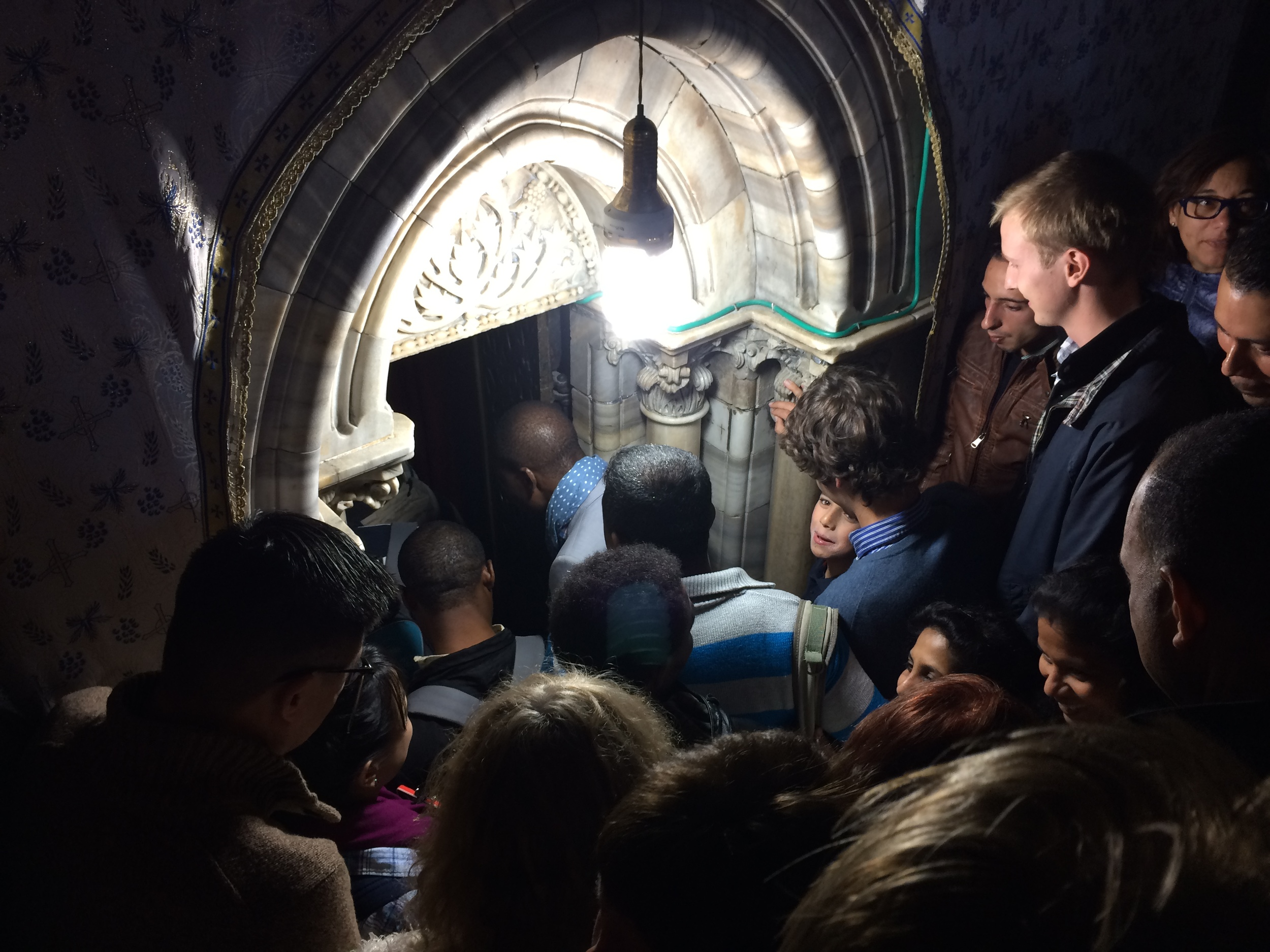 The mess of people all trying to get into the chamber downstairs with the birthplace of Jesus.