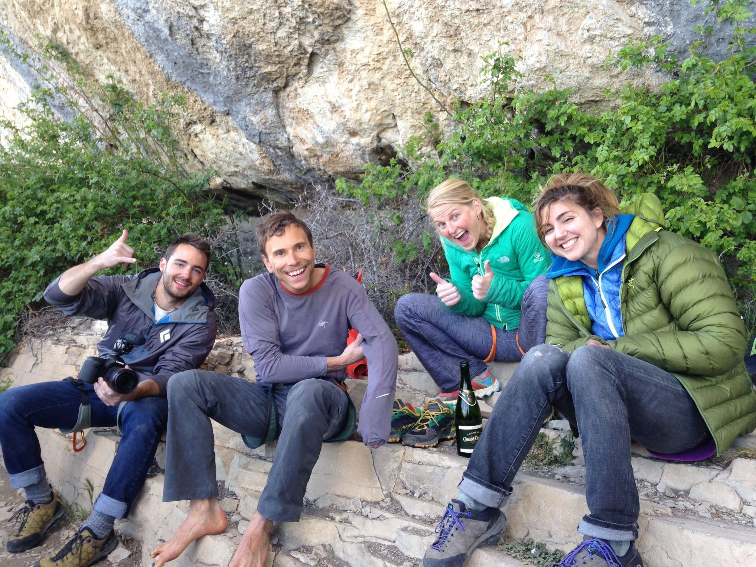 The Ceuse team celebrating at the bottom of the cliff after Jonathan's send