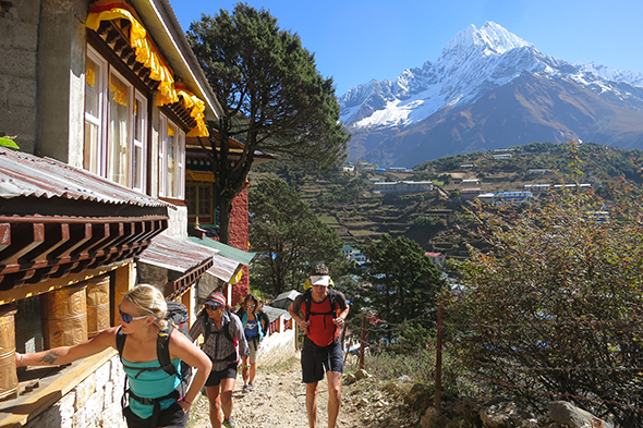 Passing the Namche Bazaar monastery on the trek to Everest Base Camp, with Thamserku in the distance; Photograph by Adrian Ballinger, Alpenglow Expeditions