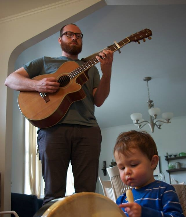 ITLM's newest and inarguably cutest member, Josh Newman, plays bass for the  Heyward Howkins  band, sings for the Silver Ages, and played for the late, great American Altitude. He cheats at Quizzo by being a librarian.