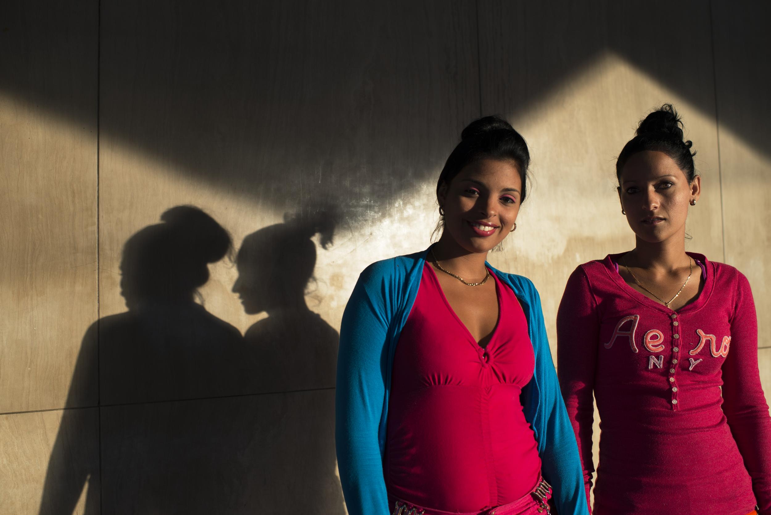 Two women pose for a portrait in Havana, Cuba on Jan. 22, 2016.
