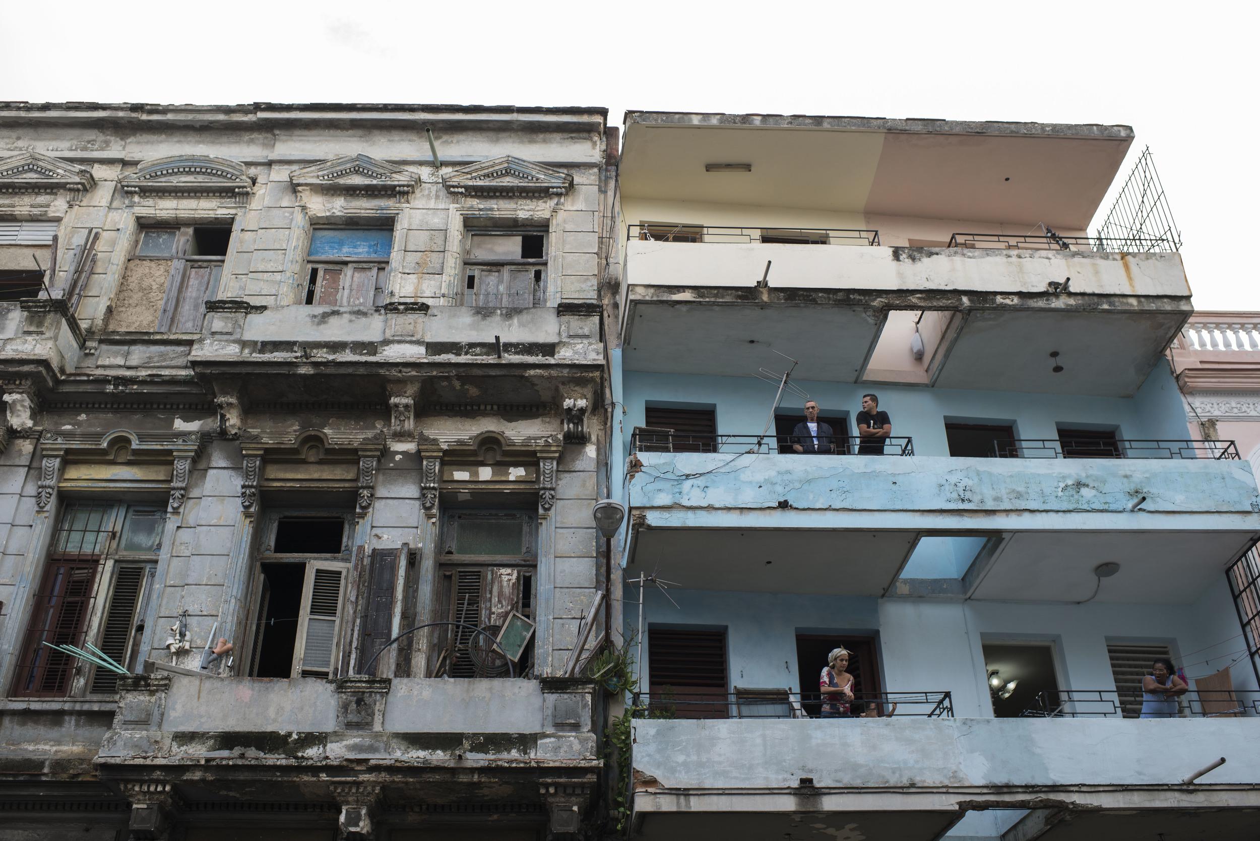 People stand on their balconies in Havana, Cuba on Jan. 17, 2016.