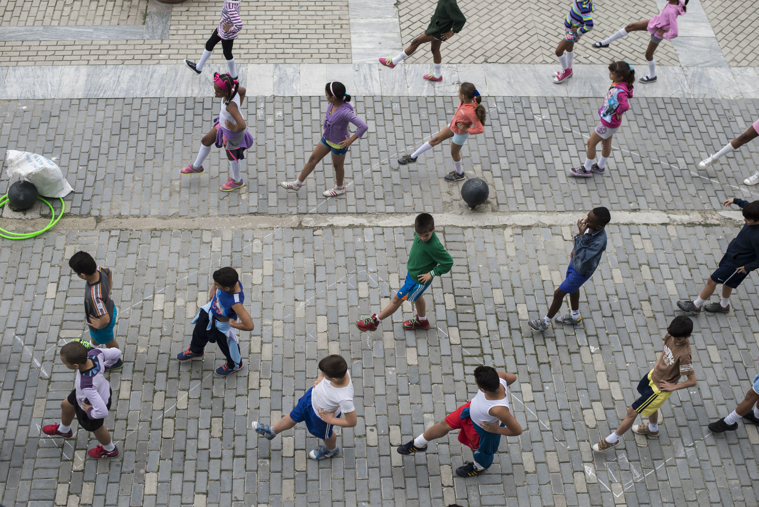School children participate in exercises in the Plaza Vieja in Old Havana, Cuba on Jan. 18, 2016.